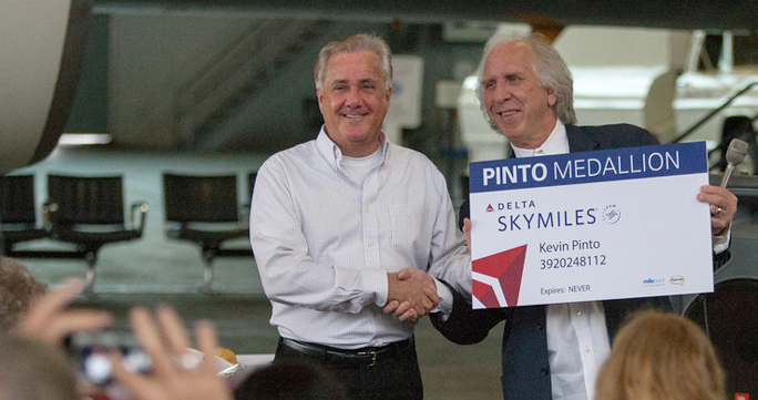 Randy Petersen presents Kevin Pinto lifetime status in the Pinto Medallion frequent flier loyalty program in March of 2013. Photograph ©2013 by Greg Johnston.