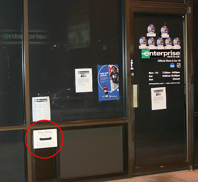 This is the front of the office of Enterprise Rent A Car; and the key drop box is located in the red circle. Photograph ©2013 by Brian Cohen.