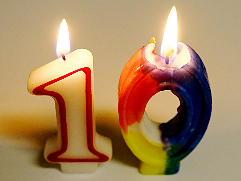 The Gate ten years 10 candles lit